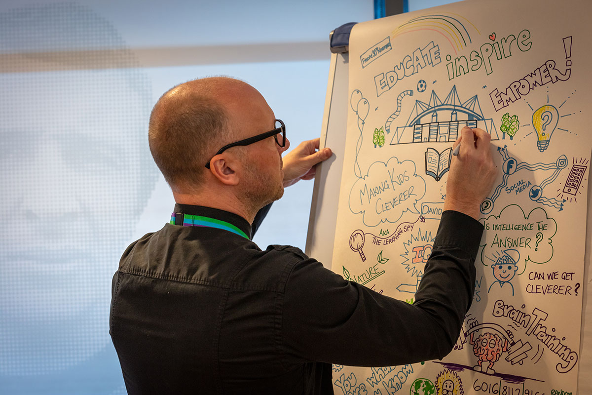Mr Eagleton live sketching our whole Trust INSET day at the Etihad Stadium in 2018